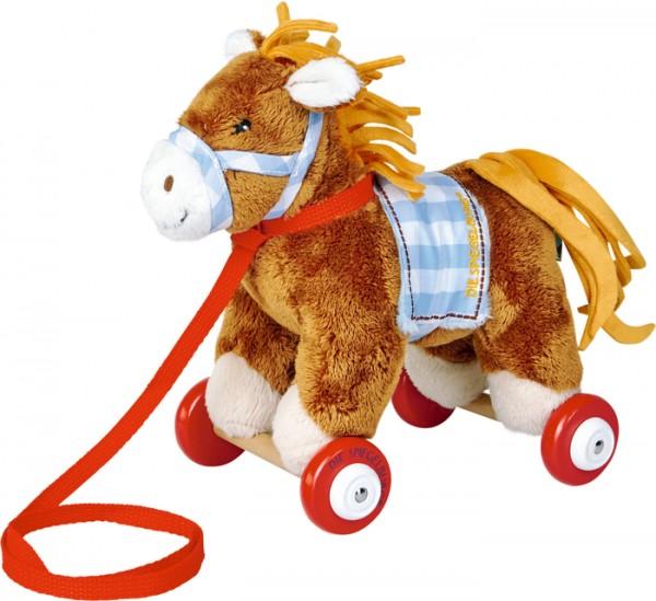 Pony Sam auf Holzrollen